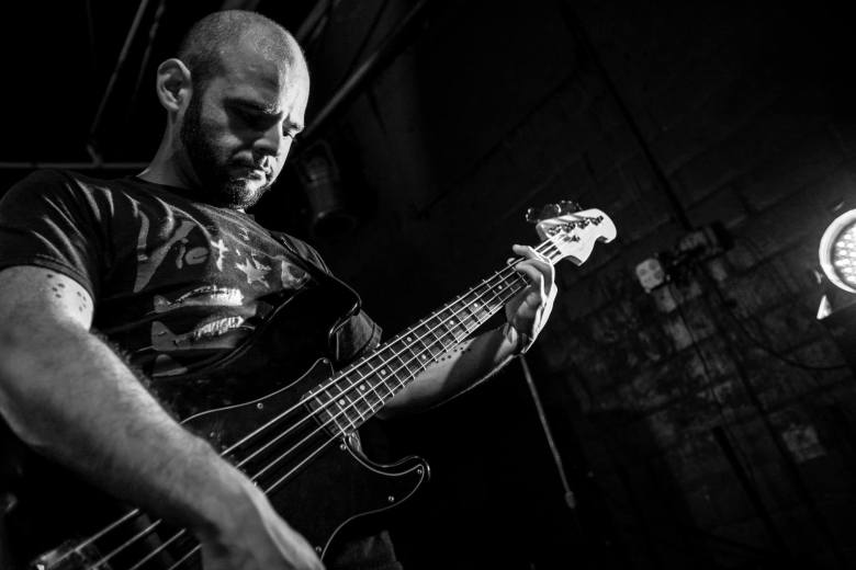 George Garza lays it down on the bass guitar.