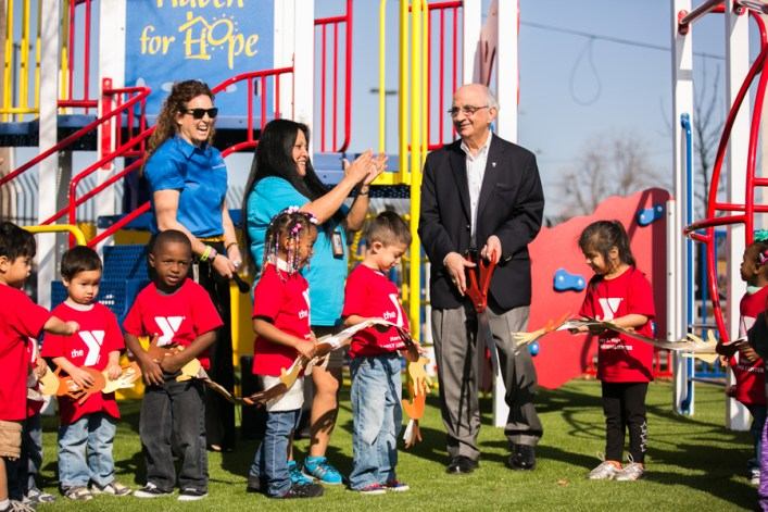 Philanthropist Harvey Najim joined children from Haven for Hope and the YMCA for a ribbon cutting ceremony for the opening of three newly installed playgrounds. Photo by Kathryn Boyd-Batstone