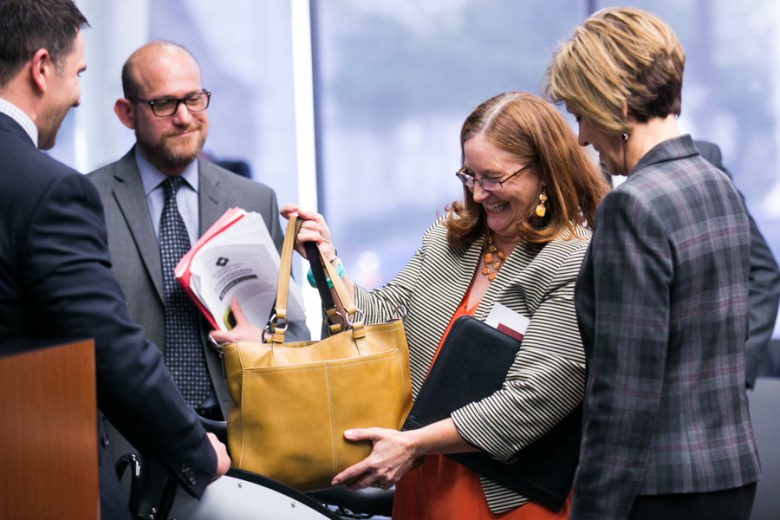Douglas R. Melnick, Chief Sustainability Officer, J. D. Simpson, executive director of San Antonio Bike Share, show City Manager Sheryl Sculley the front basket feature on the newly designed B-cycle. Photo by Kathryn Boyd-Batstone