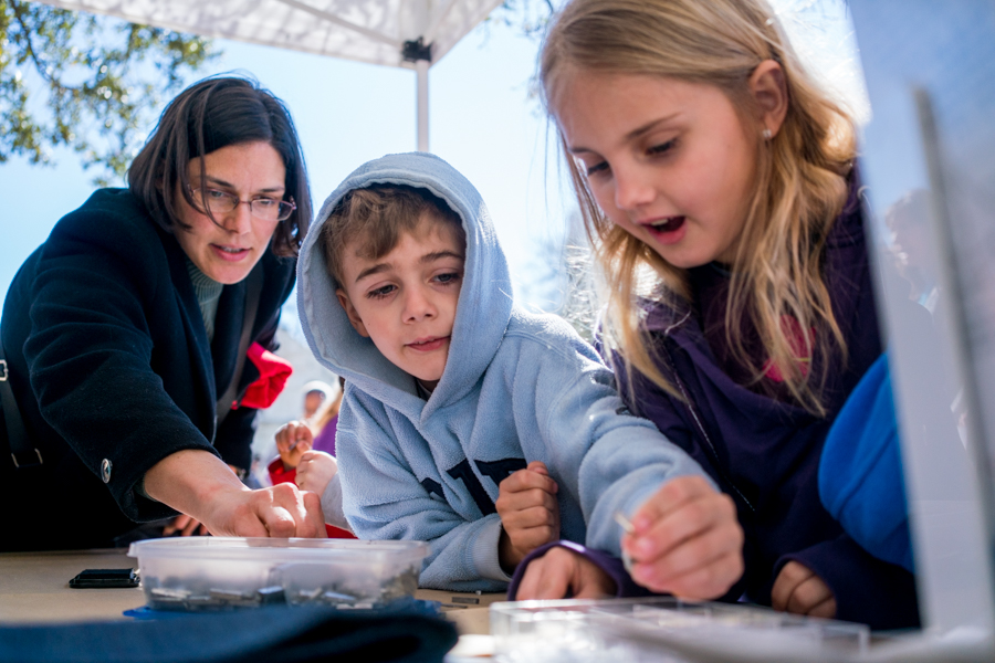 Children learn how to use a letter press as part of Living History Demonstrations. Photo by Kathryn Boyd-Batstone