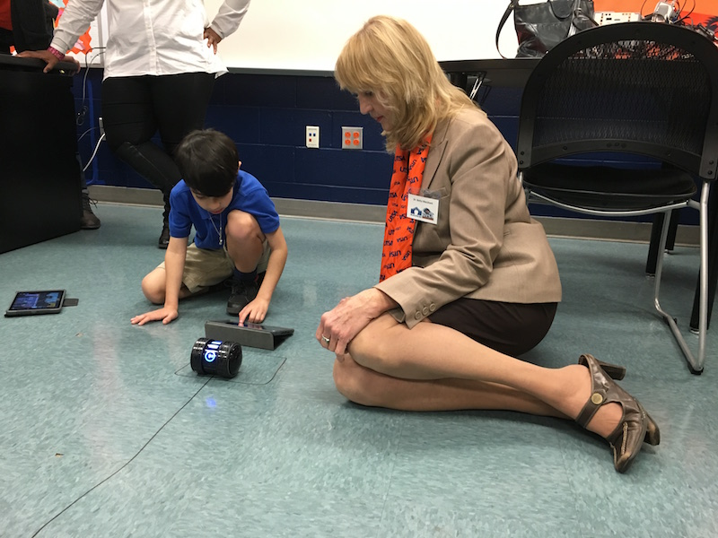 A Crockett ES student gives Dr. Betty Merchant a lab demonstration in the Roadrunner Room. Photo by Bekah McNeel