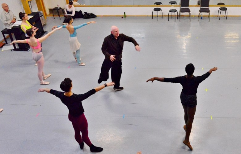 Peter Anastos coaches Christopher McDaniel on a point of technique during company warm-up, February 2016. Photo by Tami Kegley.