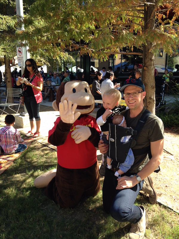 Scott Gustafson and his son Abraham, 3 spend time with the fictional storybook character Curious George. Courtesy photo.