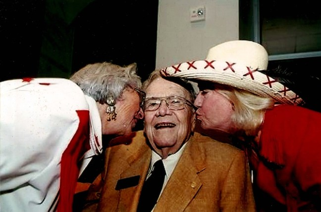 Mel Krueger (left) and Jane Macon (right) kiss the cheeks of former Texas Governor Dolph Briscoe in 2008. Photo courtesy of Jane Macon.