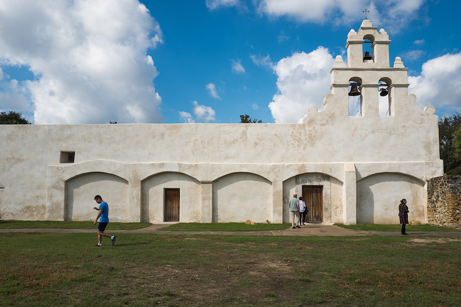 Visitors explore the grounds of Mission San Juan on a Sunday morning. Photo by Scott Ball.