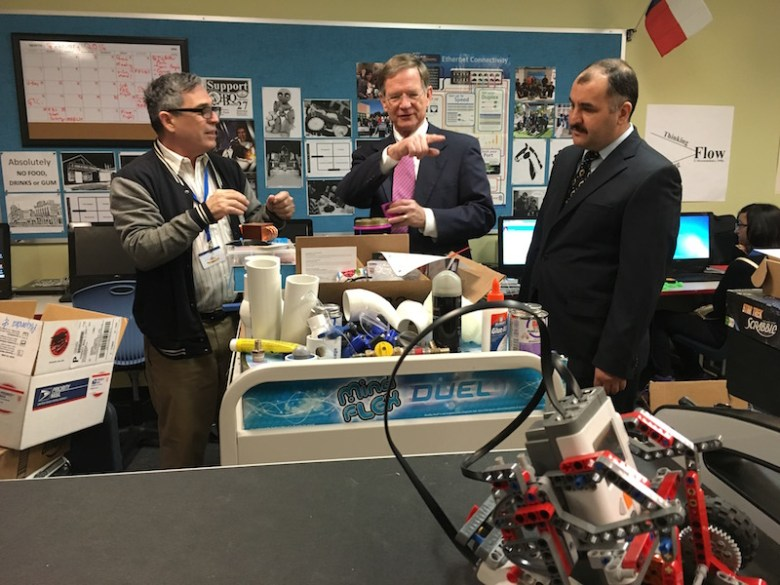 Rep. Lamar Smith (center) tours Courchesne's (left) lab with School of Science and Technology founder Turgay Korkmaz. Photo by Bekah McNeel.