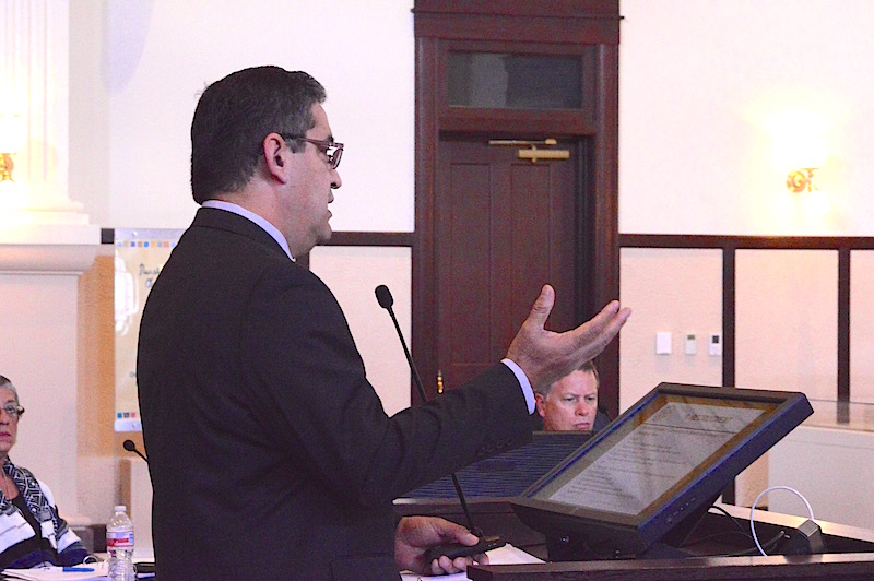 David Marquez, executive director of economic development for Bexar County, explains the county's new policy. Photo by Lea Thompson.