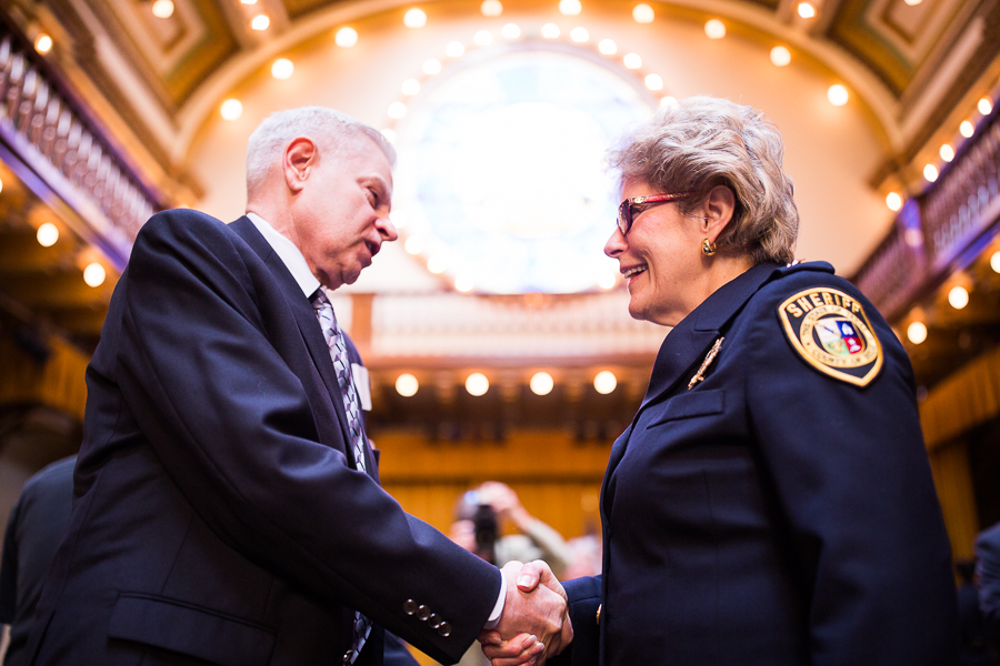 Jack Farmer from OnPoint Solutions shakes hands with Sheriff Pamerleau. Photo by Scott Ball.