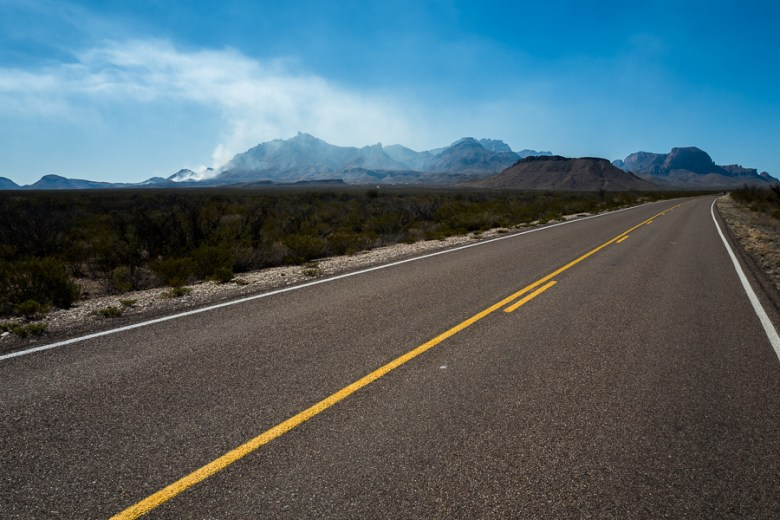 Along Texas Highway 385 South 11 miles from Big Bend National Park Headquarters shows a clear view of the smoke bellowing from the Chisos Mountains. Photo by Scott Ball.