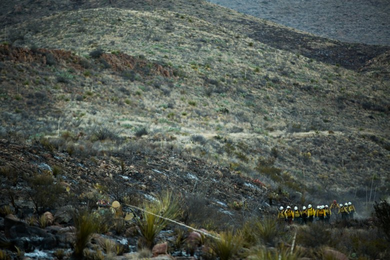 Los Diablos walk along a creek bed and navigate to Gano Springs Road where their transportation awaits them. Photo by Scott Ball..