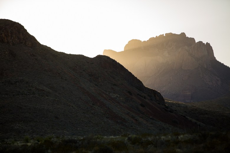 The setting sun peers through a gap in the Chisos Mountains. Photo by Scott Ball.