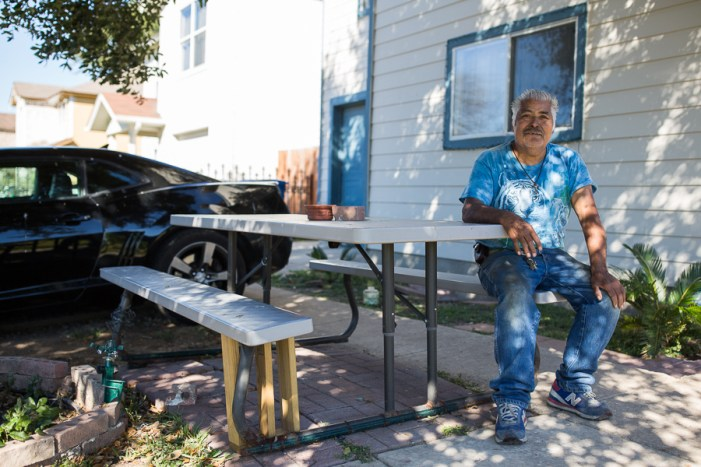 Jose Luis Nabejar is a resident of Blueridge neighborhood, one that plans on staying while continuing to repair his decaying house. Photo by Scott Ball.