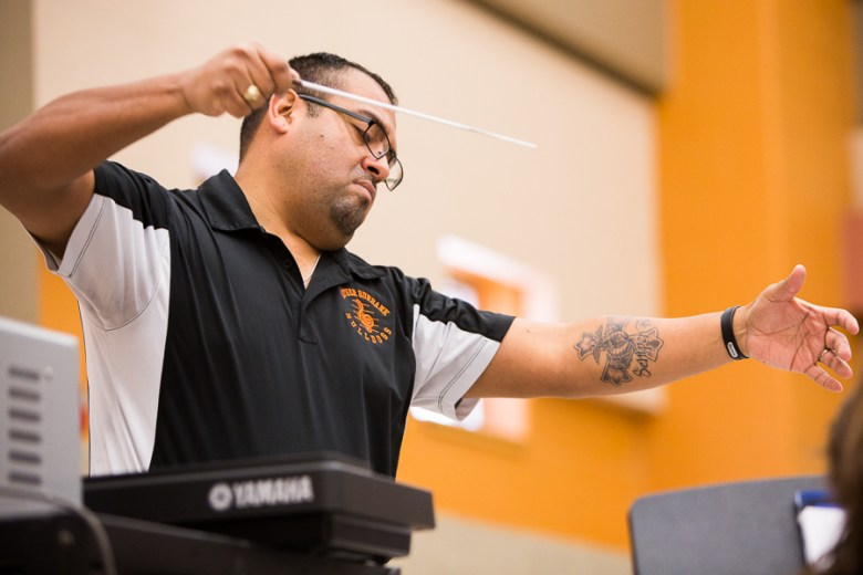 Jesse Orta leads the Burbank HS Band in concert rehearsal. Photo by Scott Ball