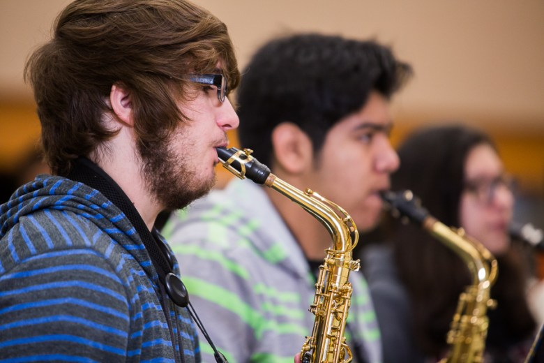 Senior Richard Johnson (l) plays the saxophone for the Burbank HS band. Johnson is also part of the International Baccalaureate Program, and hopes to head to Yale or Harvard in the fall. Photo by Scott Ball