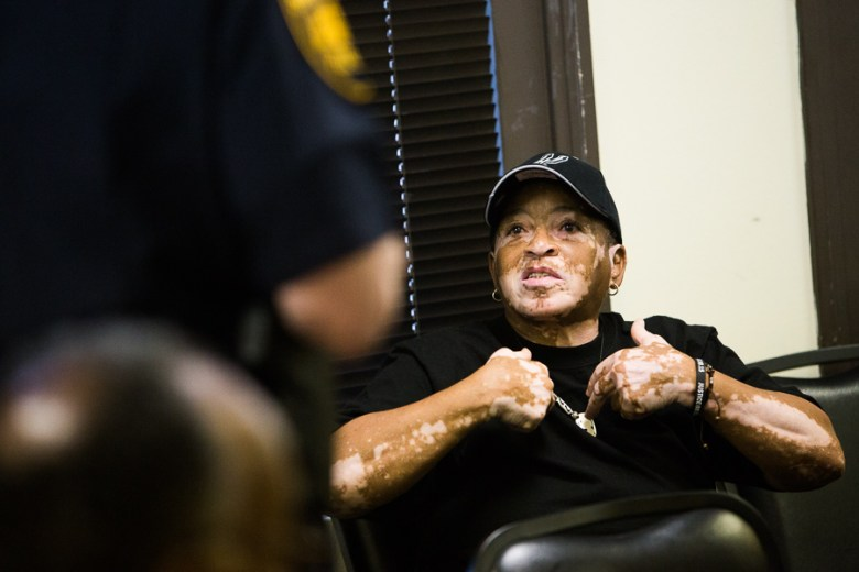 """Eastside resident and former inmate Fay Carter speaks to Chief McManus about the safety of her neighborhood. """"I was a criminal on the inside, so I know what goes on everyday."""" she said. Photo by Scott Ball."""