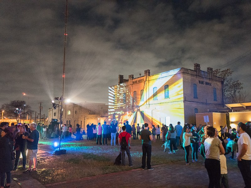 A video by artist Sam Lerma is projected onto the warehouse at the San Antonio Museum of Art. Photo by Scott Ball