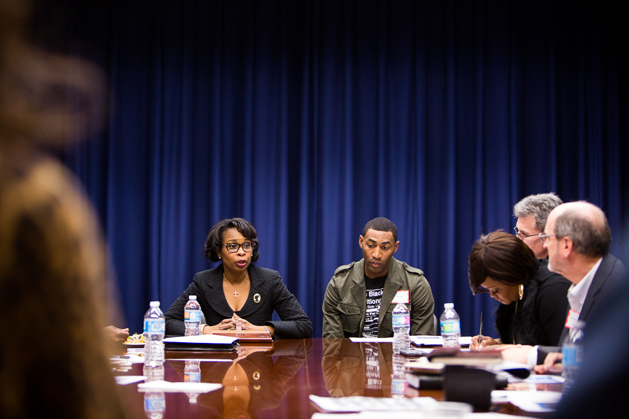 Mayor Ivy Taylor invited local activist Mike Lowe to sit next to her during the meeting. Photo by Scott Ball.