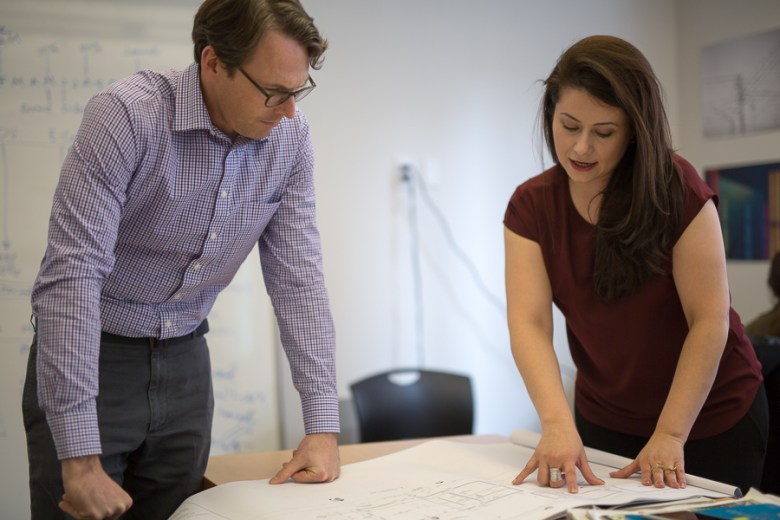 Rising Barn's Peter French and Pegy Brimhall look over plans in their office. Photo by Scott Ball.