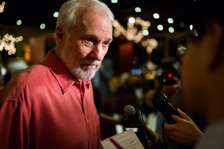 San Antonio Spurs Coach Gregg Popovich responds to interview questions before the meal is served. Photo by Scott Ball.