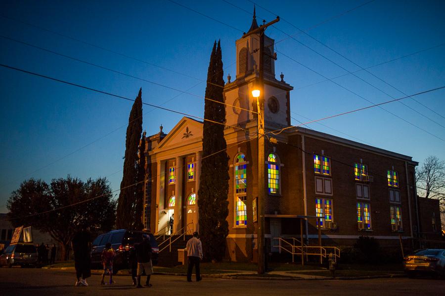 Community members walk to the New Light Baptist Church on the city's Eastside. Photo by Scott Ball.