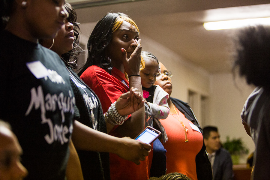 The family of Marquise Jones are asked to stand during a speech by family member Debbie Bush. Photo by Scott Ball.