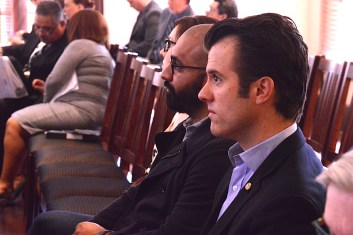 Techstars Program Manager Kara Gomez (back), Geekdom Director Lorenzo Gomez, and Cybersecurity SA Director Will Garrett listen to Bexar County Commissioners discuss the Innovation Fund. Photo by Lea Thompson.