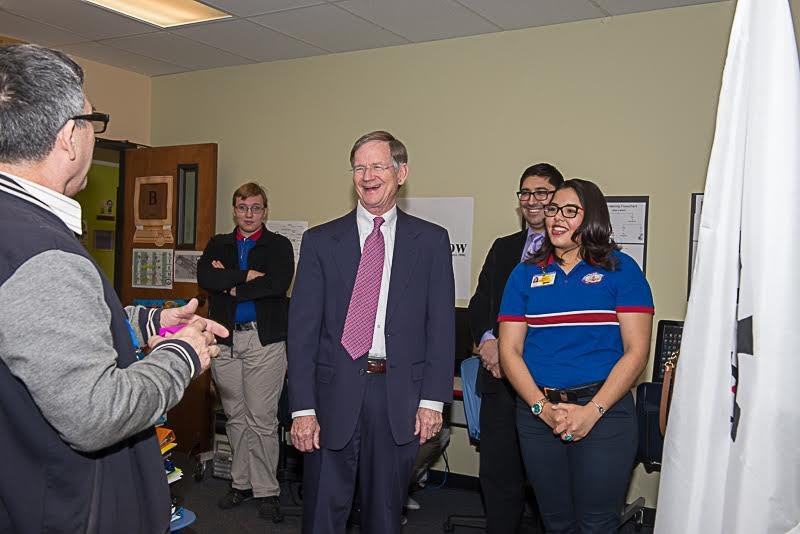 Students Kyryl Trokhymchuk (left) and Natalie Salazar (right) welcome U.S. Rep. Lamar Smith into their classroom. Photo by Lorraine Aguirre.