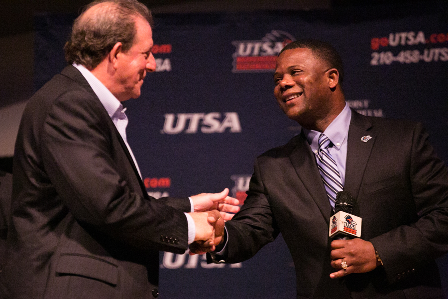UTSA's new head football Coach Frank Wilson greets new Offensive Coordinator Quarterback coach Frank Scelfo. Photo by Kathryn Boyd-Batstone