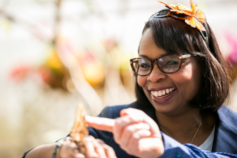 Mayor Ivy Taylor smiles as a butterfly lands on her. Photo by Kathryn Boyd-Batstone