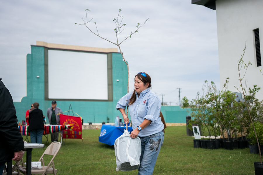 Julia Favre gives away a Live Oak tree. Photo by Kathryn Boyd-Batstone