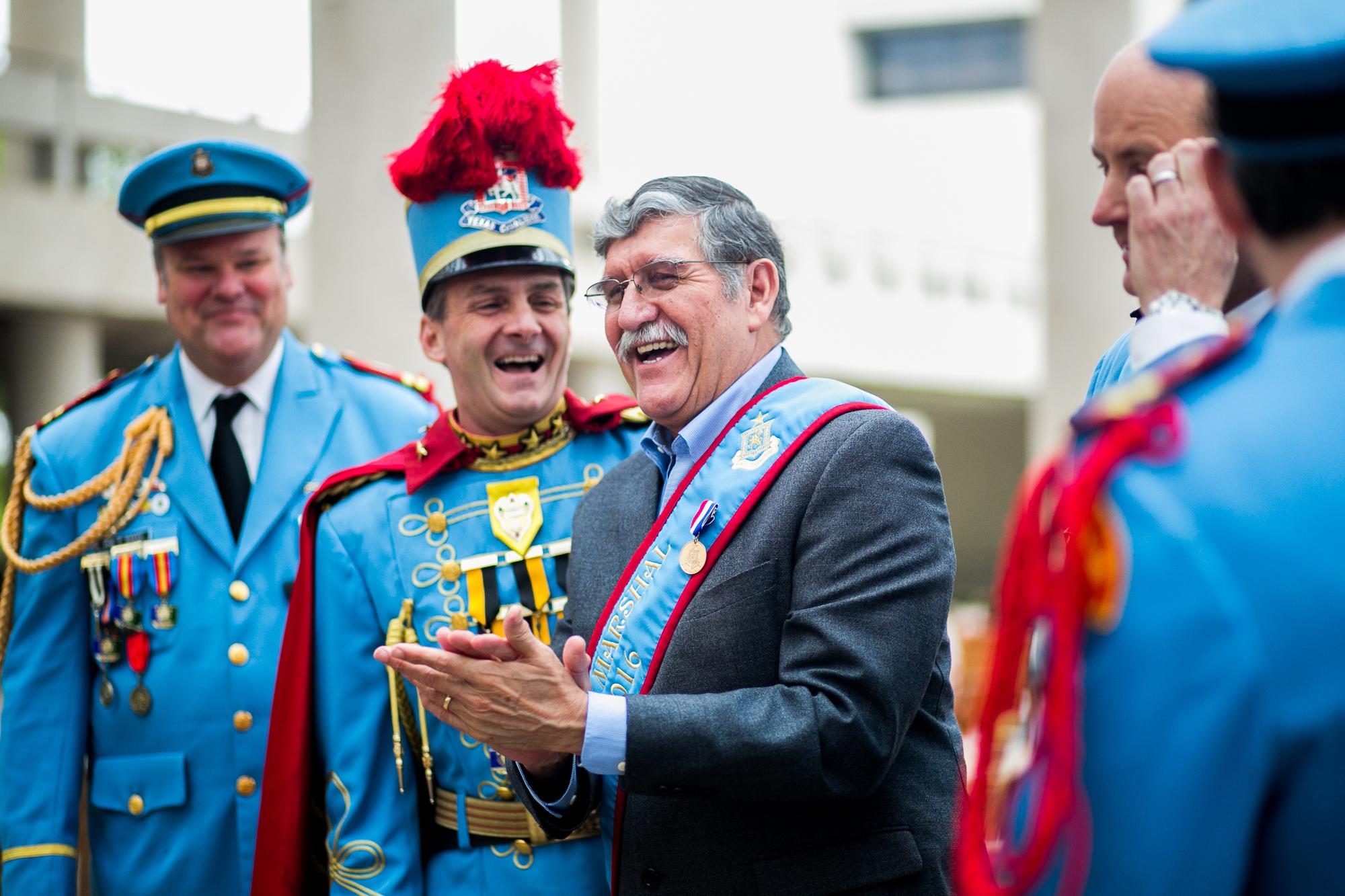 UTSA President Dr. Ricardo Romo shares a laugh with The Texas Cavaliers. Photo by Kathryn Boyd-Batstone