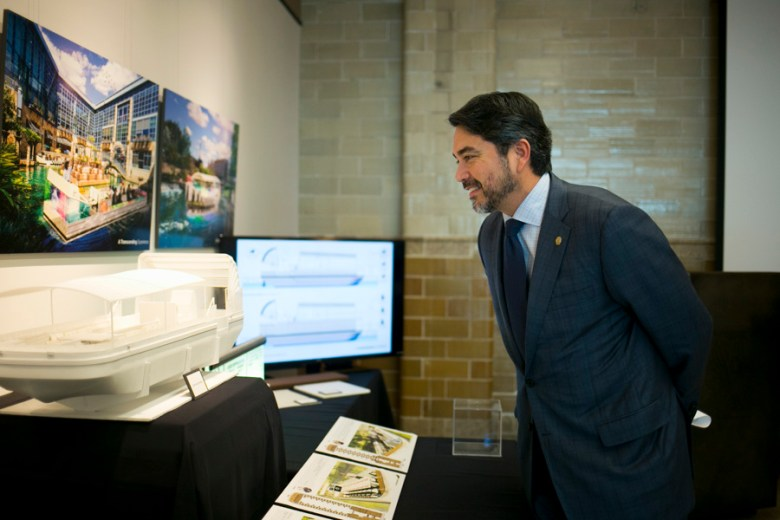 Councilman Roberto Treviño (D1) looks at the A Transcending Experience team barge. Photo by Kathryn Boyd-Batstone