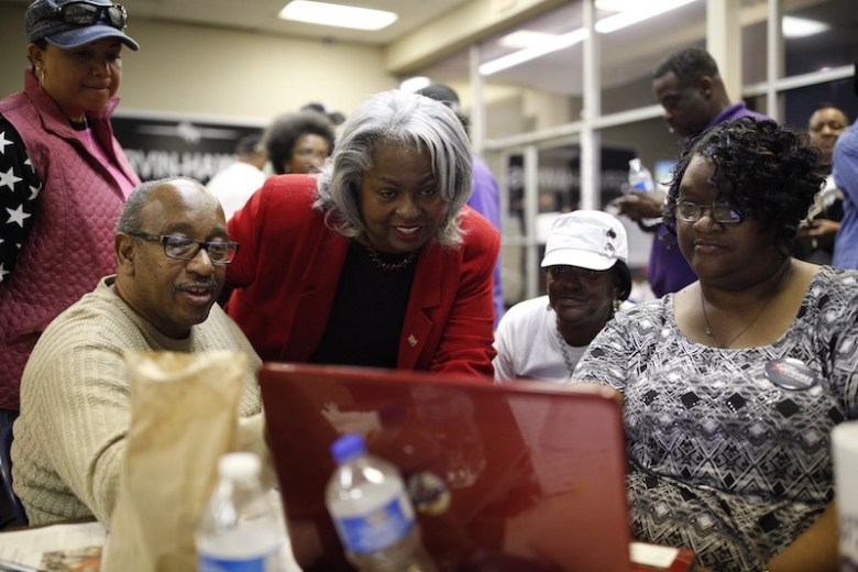 Candidate Barbara Gervin-Hawkins glances at results on a computer screen. Photo by Scott Ball.