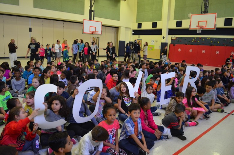 Driggers Elementary students await Principal Mary Helen Cover in the school gym to surprise her. Photo by Camille Garcia.
