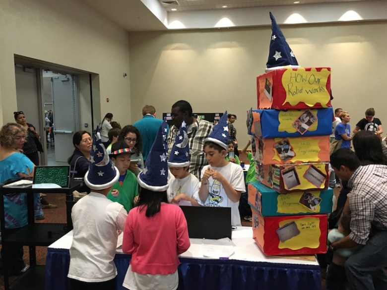 The Jr. FIRST Lego League hard at work on their robots. Photo by Bekah McNeel