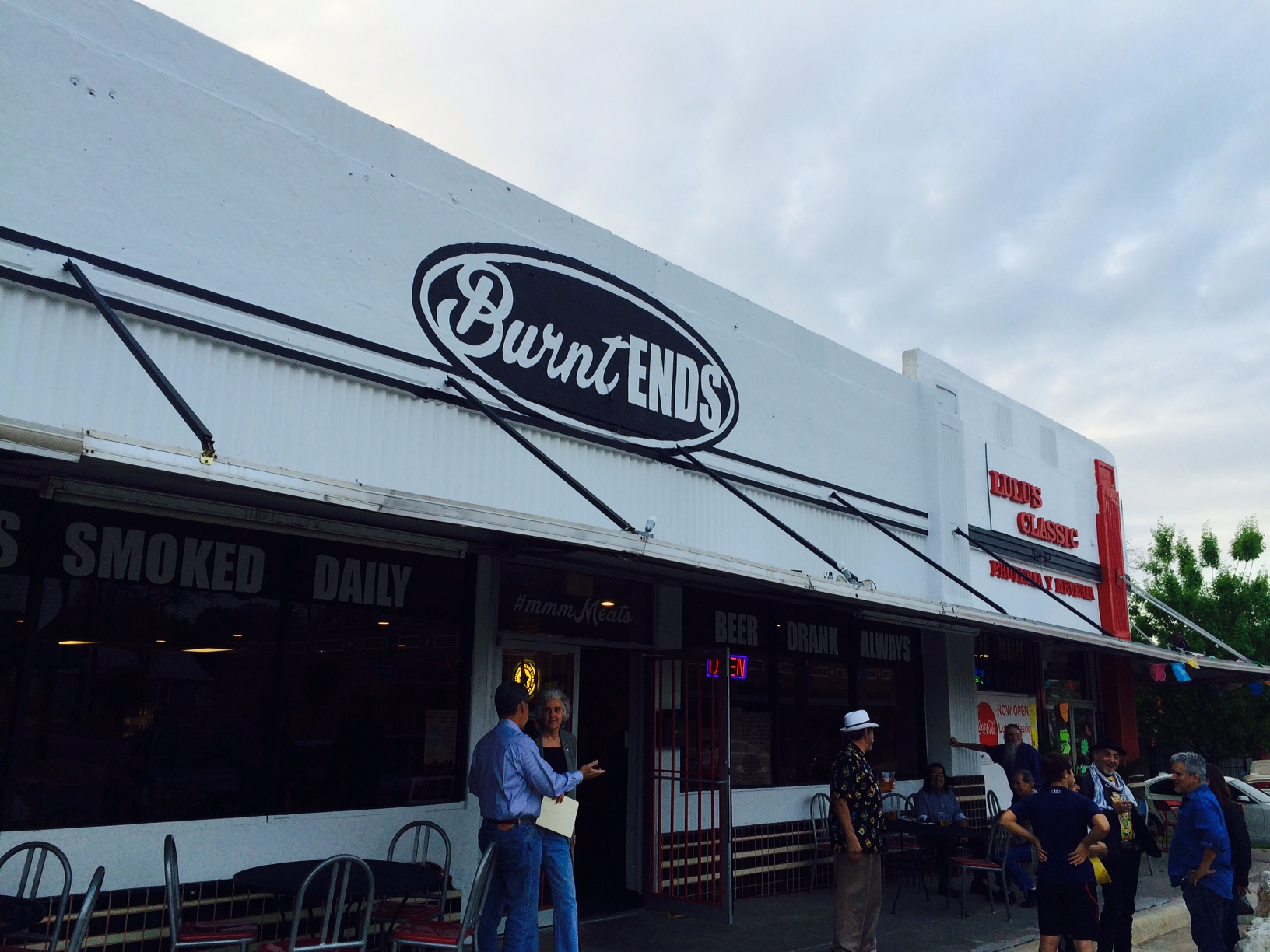 Musicians and patrons hang outside of Burnt Ends BBQ. Photo courtesy of Adam Tutor