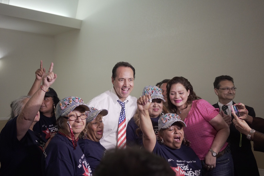 State Sen. José Menéndez smiles with his supporters as victory is announced. Photo by Kathryn Boyd-Batstone.