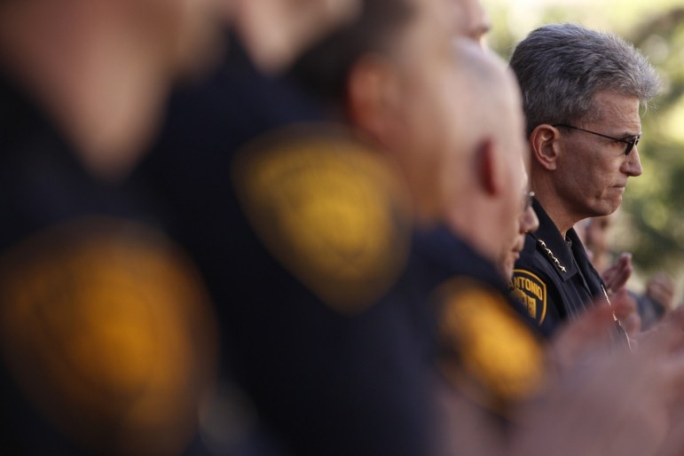 Chief William McManus reacts as his supporters including uniformed officers applaud his service. Photo by Scott Ball.
