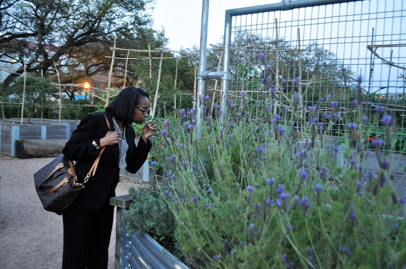 Mayor Ivy Taylor stops to smell flowers in the McGovern Centennial Gardens in Hermann Park, Houston. Photo by Iris Dimmick.