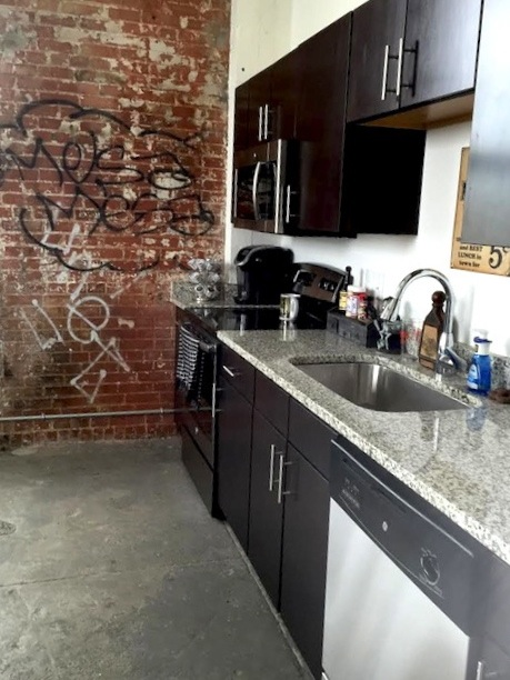 The small kitchen in my apartment inside The Peanut Factory Lofts. Photo by Mike Price.