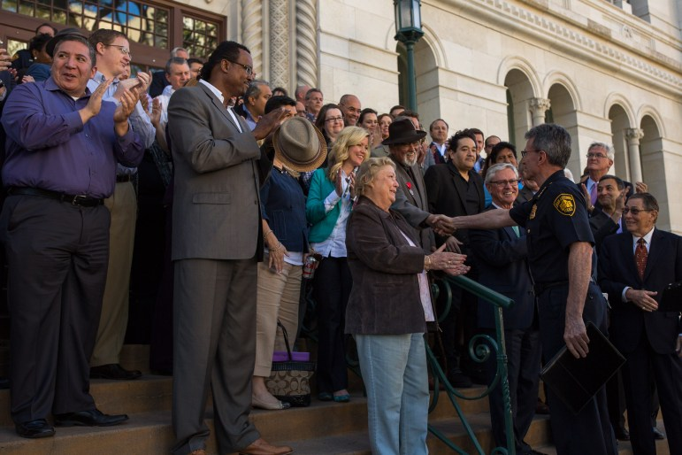 Chief William McManus greets his supporters on the steps of City Hall. Photo by Scott Ball.