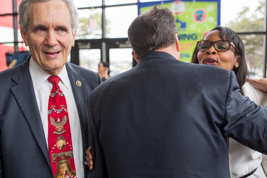 SAISD Superintendent Pedro Martinez (center) hugs Mayor Ivy Taylor as Congressman Lloyd Doggett (D35) passes. Photo by Scott Ball.