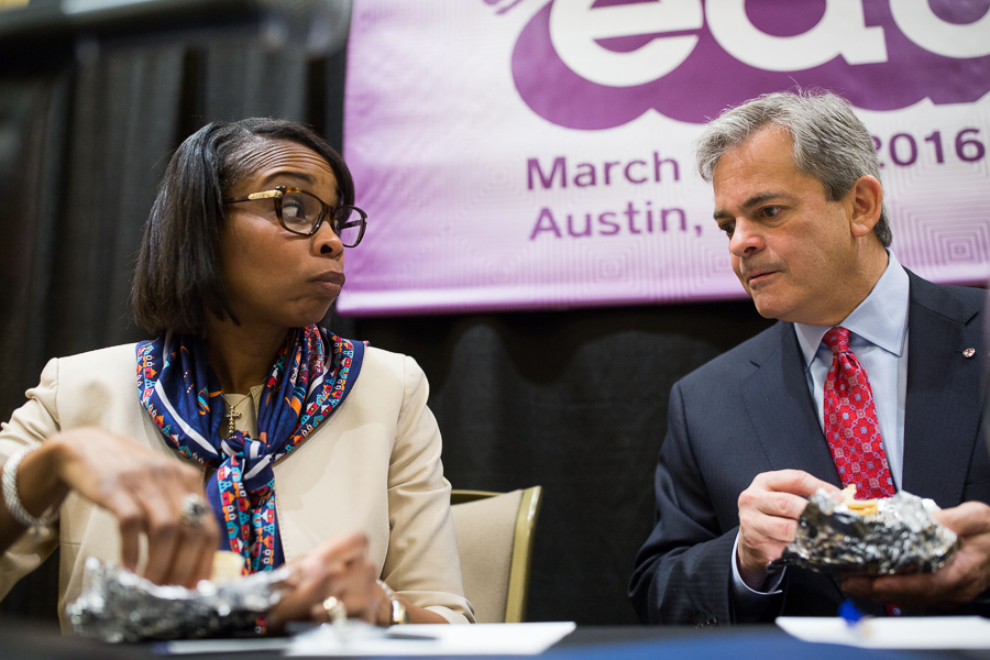 After the taco dust had settled Austin Mayor Steve Adler and Mayor Ivy Taylor discuss the day ahead in which they will be on a panel during the SXSW Education conference. Photo by Scott Ball.