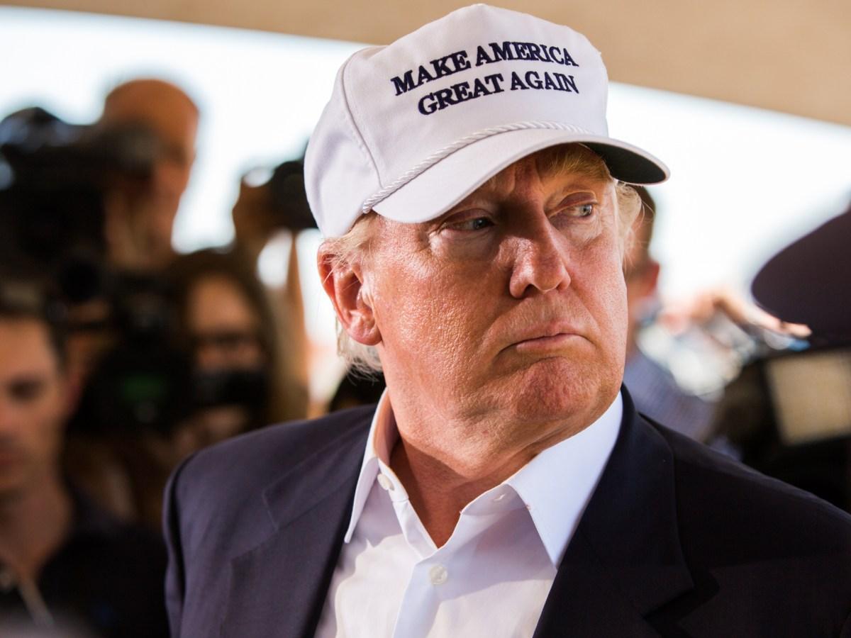Donald Trump looks behind his shoulder before he calls Laredo Mayor Pete Saenz to the podium to speak. Photo by Scott Ball.