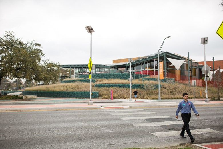DoSeum Executive Assistant Michael Garcia crosses the newly constructed z-crossing. Photo by Scott Ball.