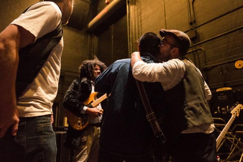 Omar Rosel of Fishermen kisses fellow bandmate Gabe Medina following their performance. Photo by Scott Ball.