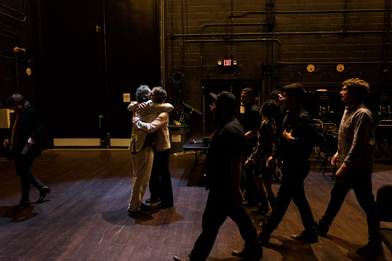 Erik Sanden and Joe Reyes of Buttercup embrace following the performance of Abbey Road Live. Photo by Scott Ball.