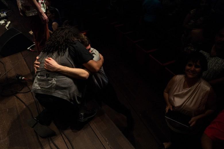 Darian Thomas embraces a friend following his performance. Photo by Scott Ball.