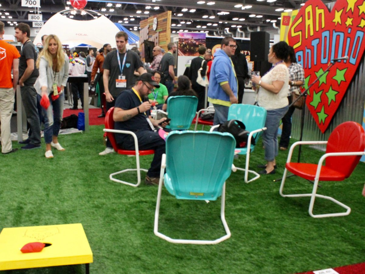 Visitors to the South by Southwest trade show toss bean bags at the Choose San Antonio space on Sunday, March 13, 2016. Photo by Edmond Ortiz