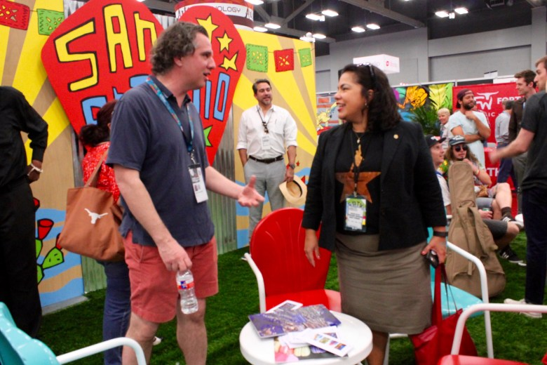 San Antonio City Councilwoman Rebecca Viagran (D3) chats with a visitor at the Choose San Antonio trade show space during South by Southwest on Sunday, March 13, 2016. Councilman Roberto Trevino is in the background. Photo by Edmond Ortiz
